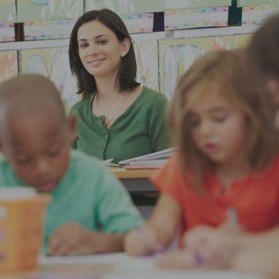 Teacher watching students take test